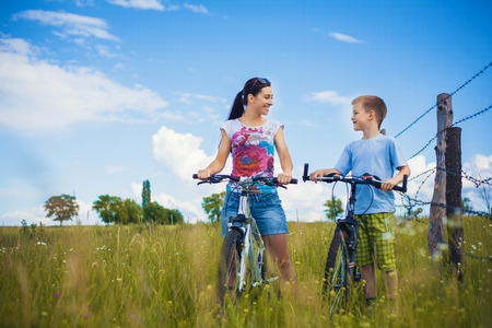 family. mother and son riding  in the park Stock Photo