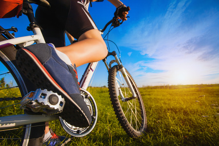 foot on pedal of bicycle. active summer photo