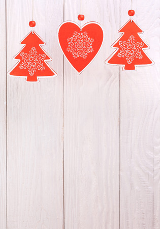 Christmas decoration hanging over white wooden background Stock Photo