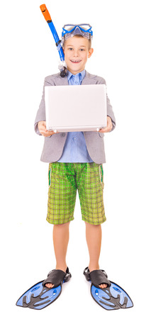 kid businessman wearing fins, snorkel and goggles photo