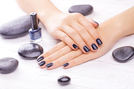 black stones: black manicure with black stones Stock Photo