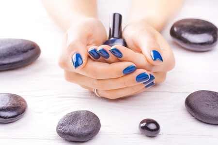 black stones: blue manicure with black stones