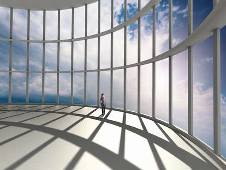 businesswoman standing in office and looking at sky in window Stock Photo