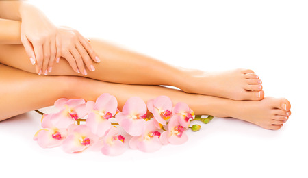 french pedicure: manicure and pedicure with a pink orchid flower Stock Photo