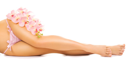 french manicure sexy woman: Relaxing pedicure with a pink orchid flower