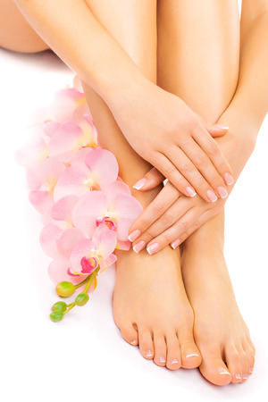 pedicure: manicure and pedicure with a pink orchid flower Stock Photo