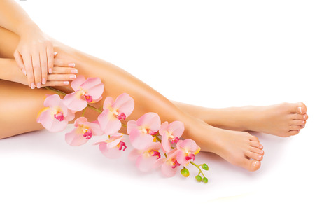 Relaxing manicure and pedicure with a pink orchid flower 版權商用圖片
