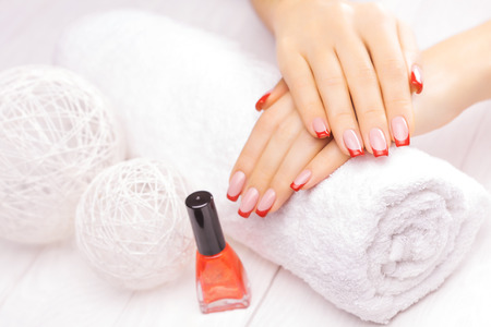 beautiful french manicure with red poppy flower