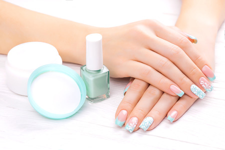 beautiful turquoise french manicure with light towel Standard-Bild