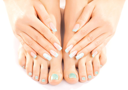 pedicure: beautiful feet with turquoise pedicure isolated