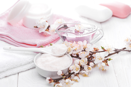 relaxation background: still life of sea salt and essential oils and apricot flowers Stock Photo