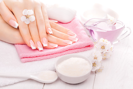 french manicure with essential oils, apricot flowers. spa Stockfoto