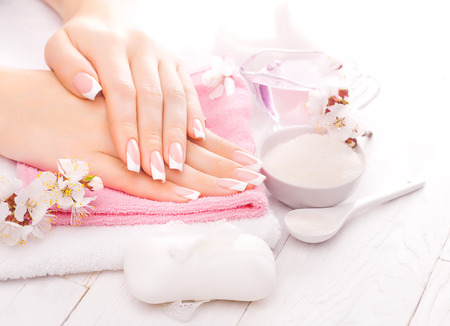 french manicure with essential oils, apricot flowers. spa Archivio Fotografico