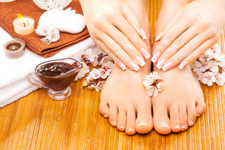 brown manicure and pedicure on the bamboo