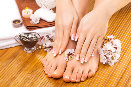 pedicure: brown manicure and pedicure on the bamboo