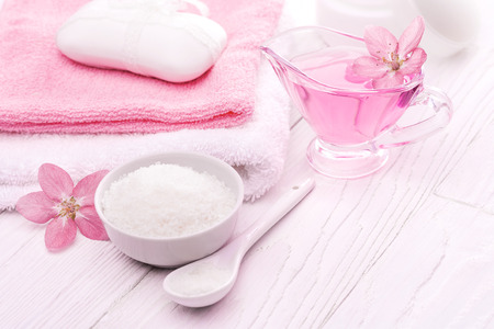 sea salt and essential oils, pink flower. spa Stock Photo