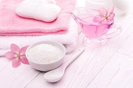 sea salt and essential oils, pink flower. spa Reklamní fotografie