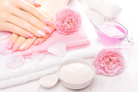 tea towel: french manicure with essential oils, rose flowers. spa