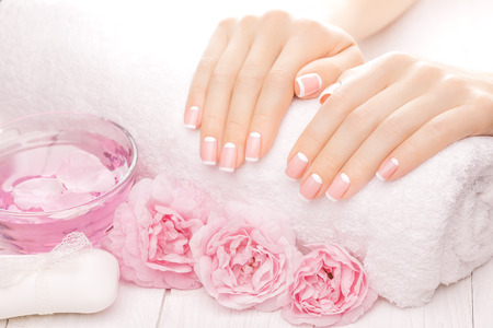 spa treatments: french manicure with rose flowers. spa Stock Photo