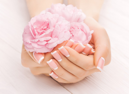 french manicure with rose flowers. spa Archivio Fotografico