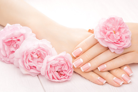 french manicure with rose flowers. spa 스톡 콘텐츠