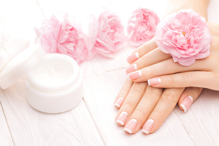 beautiful french manicure with pink tea rose flowers