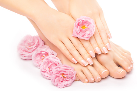 pedicure and manicure with a pink rose flower 스톡 콘텐츠