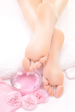 sooth: Foot massage in the spa with pink rose