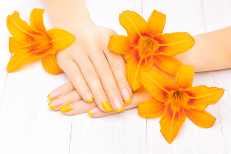 orange lily: beautiful french manicure with orange lily flowers