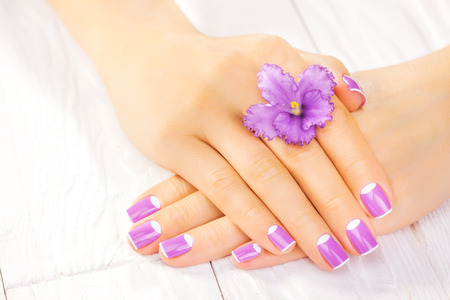 beautiful french manicure with purple violet flowers