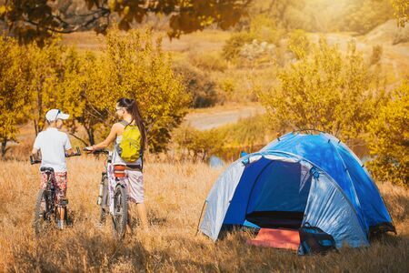 camping tent: mom and son is camping in the park