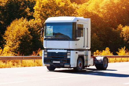 country highway: white truck is driving on the country highway Stock Photo