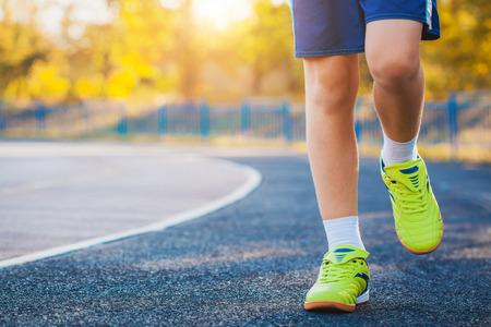outdoor shot: Runners Feet Running on Stadium. Closeup - outdoor shot