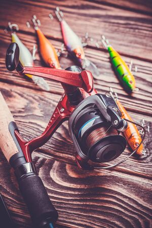 stocked: set of fishing tackle on a wooden table