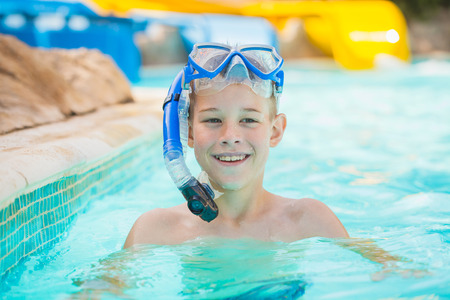 Pretty little boy in swimming pool photo