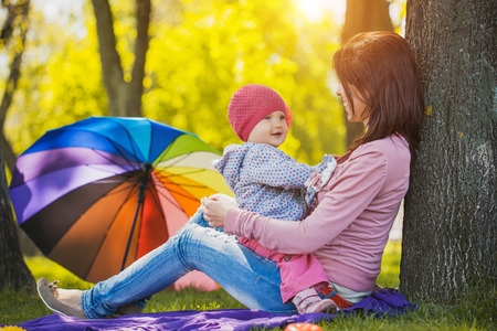 portrait of woman: Mother And Baby outdoors. Nature. Beauty Mum and her Child playing in Park together.