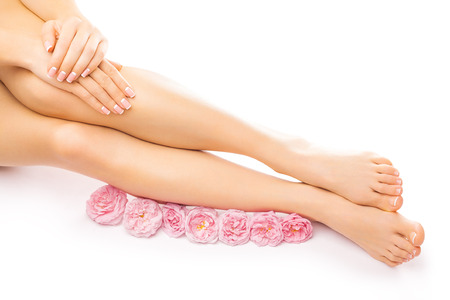 manicure and pedicure: french pedicure and manicure with a pink rose flower isolated on the white