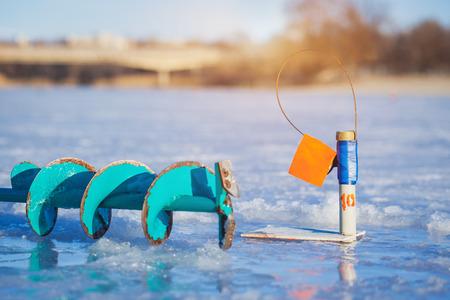 ice fishing: Ice Fishing on the winter Lake Stock Photo