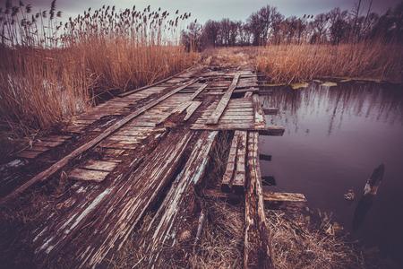 foot bridges: old wooden bridge over the river. landscape Stock Photo