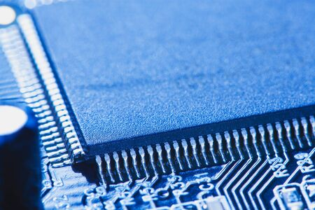 microchip integrated on motherboard. blue Stock Photo