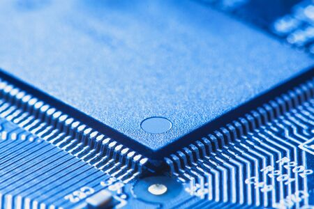 microchip: microchip integrated on motherboard. blue Stock Photo
