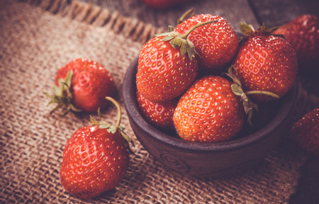 sweet and savoury: Strawberry in a Bowl on the wooden table