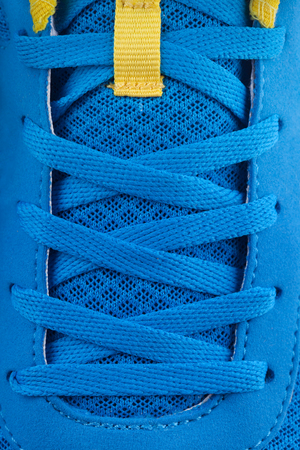 shoe laces: Shoe laces of a blue new sneakers. macro Stock Photo