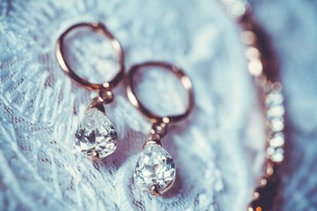 stetting: Fine jewelry: earrings on the white wedding dress