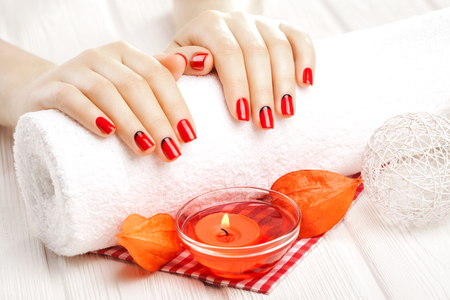 red manicure with dekor. spa