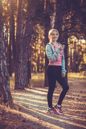 nice young girl on morning joging in a summer forest