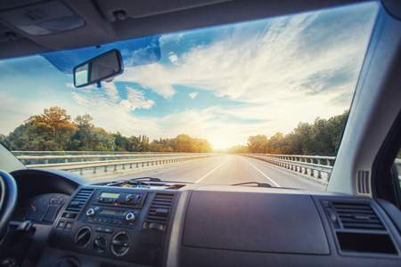 Car dashboard and steering wheel inside of car. Travel concepte Standard-Bild