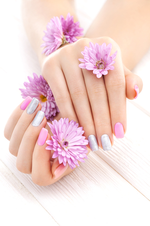 pink manicure with chrysanthemum flowers.