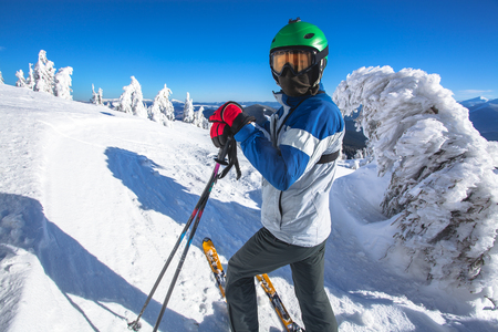 Man skier on a slope in the mountains Stock Photo