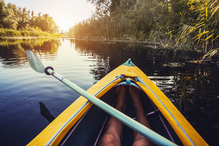 First person view kayaking through clear water. leisure activity Banco de Imagens